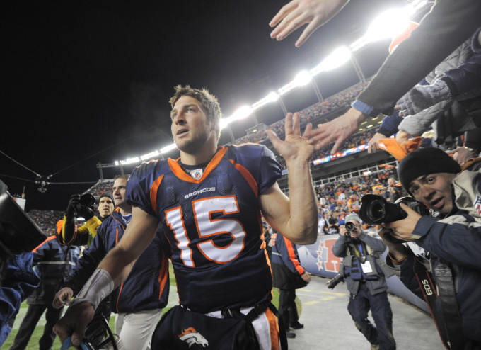 Tebow celebrates on Jan. 8, 2012. (AP)