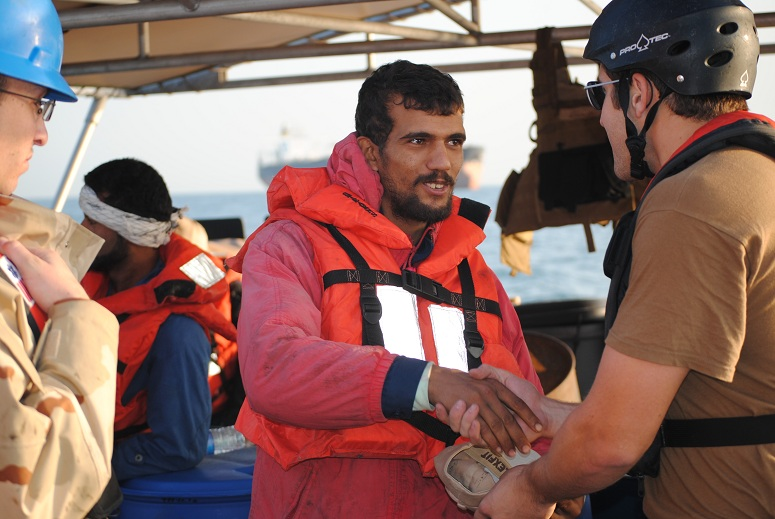 An Iranian mariner greets a US Coast Guardsmen Jan 10, 2012. (Centcom/Defense Department)