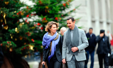 Syrian President Bashar al-Assad and his wife, Asma, in Paris 2010. (Miguel Medina/AFP/Getty Images)
