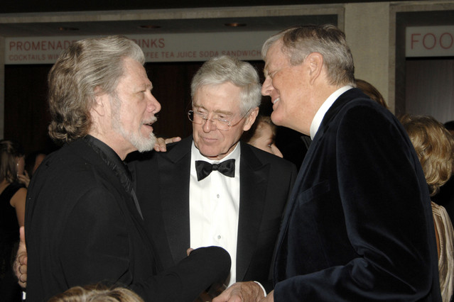 Charles and David Koch with singer Samuel Ramey in New York, Nov. 2009. (Patrick McMullan/PatrickMcMullan.com)