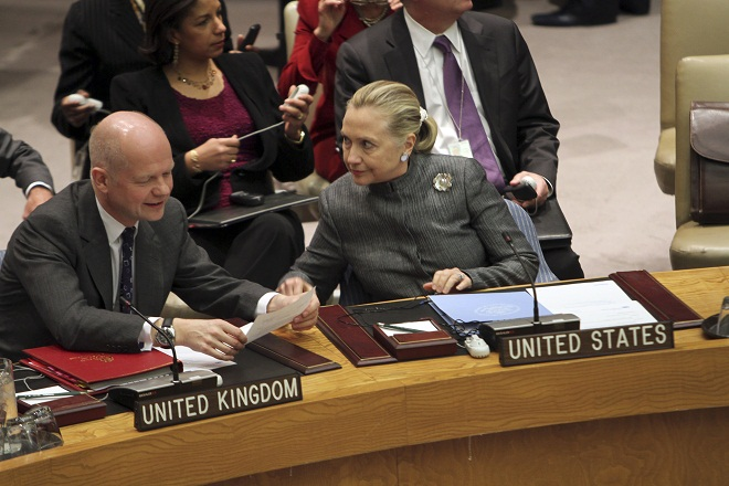 Secretary of State Hillary Clinton confers with UK Foreign Secretary William Hague at UN Jan. 31, 2012. (Mary Altaffer/AP)