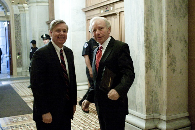 Sen. Lindsey Graham and Sen. Joseph Lieberman on Capitol Hill March 9, 2010. (Harry Hamburg/AP)