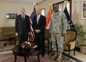 U.S. Vice President Joe Biden, center, is seen with Ambassador to Iraq James F. Jeffrey, left, and Gen. Lloyd Austin, the top U.S. commander in Iraq, in Baghdad, Iraq, on Jan. 13, 2011. (Maya Alleruzzo/AP)