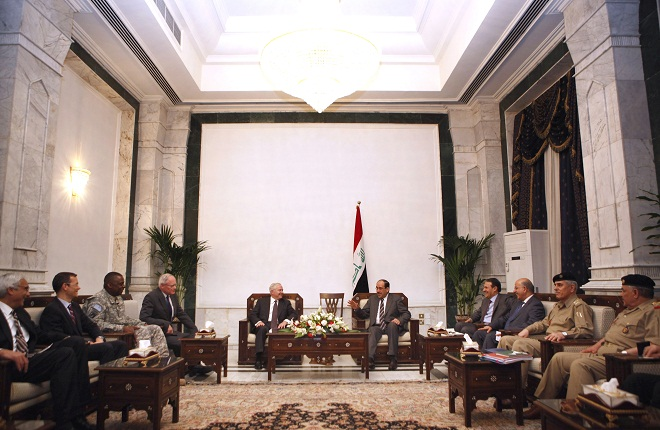 Then Defense Secretary Robert Gates met with Iraqi Prime Minister Nouri al-Maliki in Iraq in April 7, 2011. Amb. Jim Jeffrey is to Gates' right. (Chip Somodevilla/AP)