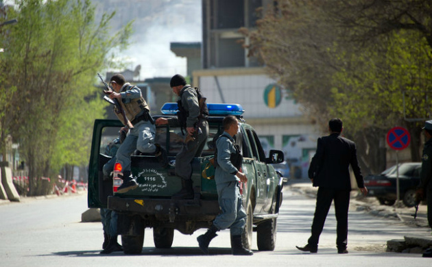 Afghan police moving toward the scene of an attack in Kabul on April 15, 2012. (Getty)