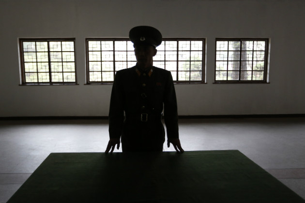 A North Korean military officer talks speaks at a museum in Panmunjom, North Korea, April 23, 2012. (Vincent Yu/AP)
