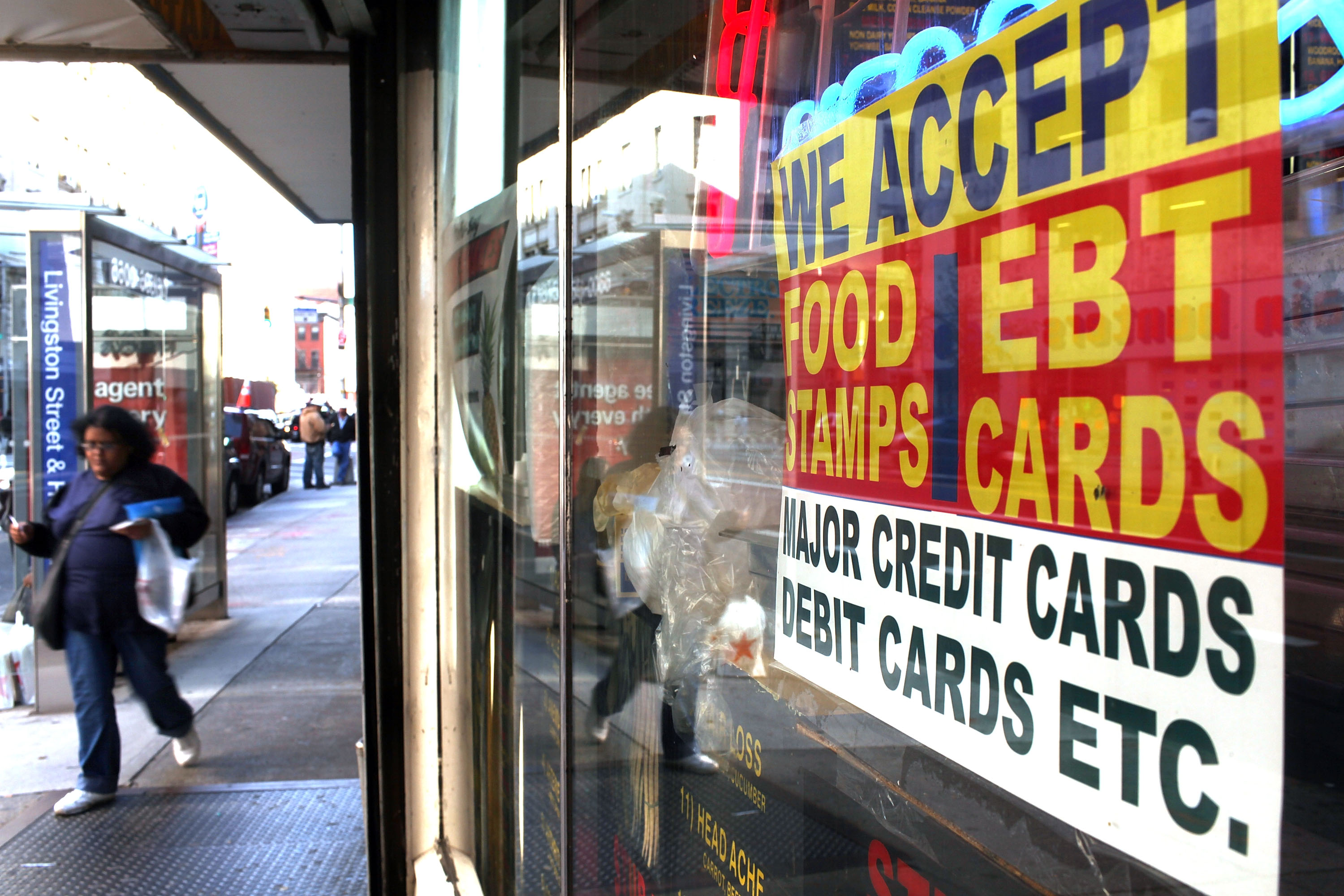 A sign in a New York City market window advertises the acceptance of food stamps. (Getty)