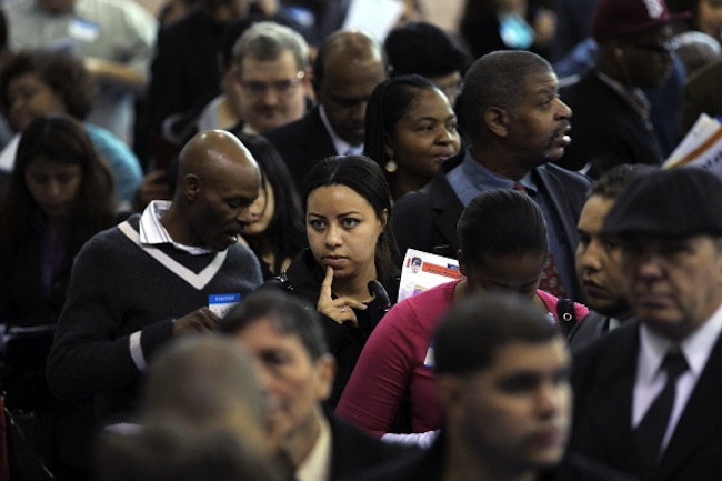 People wait in line at a jobs fair in Queens, N.Y., earlier this week. (Spencer Platt/Getty)