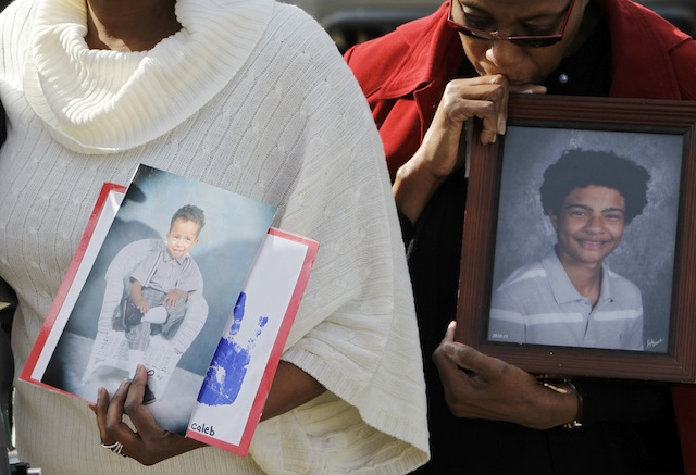 Family members hold photos of Caleb Gordley in Sterling, Va. (Associated Press/Ann Heisenfelt)