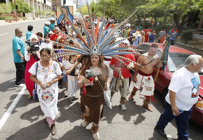 Hundreds of immigrants protesters on the one-year anniversary of SB1070. (AP Photo/Ross D. Franklin)