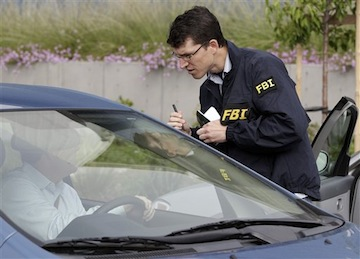 An FBI agent questioning a Solyndra worker Sept 8 (AP)