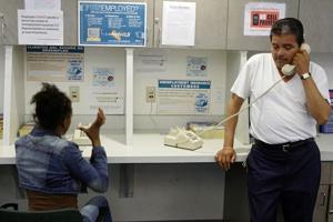 Unemployed workers at a Los Angeles-area employment center. AP Photo/Damian Dovarganes
