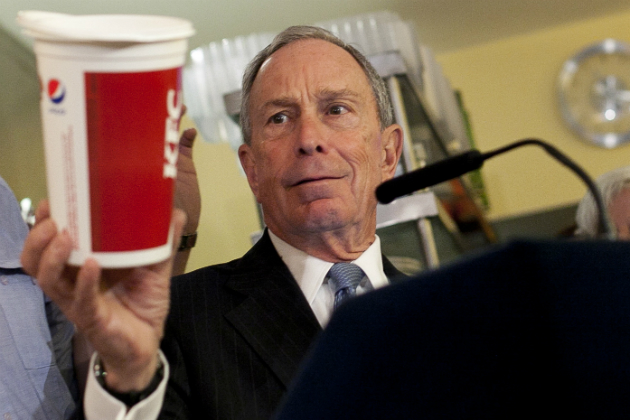 Bloomberg holds up a 24-ounce soda cup at a news conference. (Allison Joyce/Getty Images)