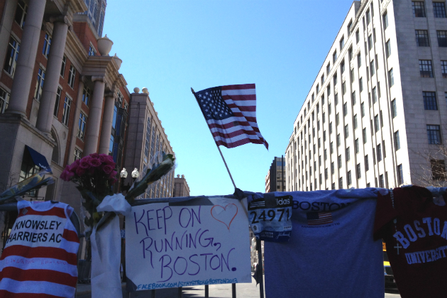 An American flag attached to a barrier near the site of the Boston Marathon bombings. (Dylan Stableford/Yahoo News)