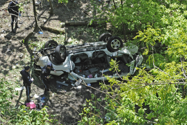 Police investigate the van that plunged over the Bronx River Parkway, April 29, 2012. (Louis Lanzano/AP)