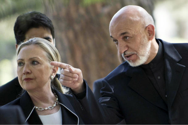 U.S. Secretary of State Hillary Clinton walks with Afghan President Hamid Karzai in Kabul, July 7, 2012. (AP/Pool)