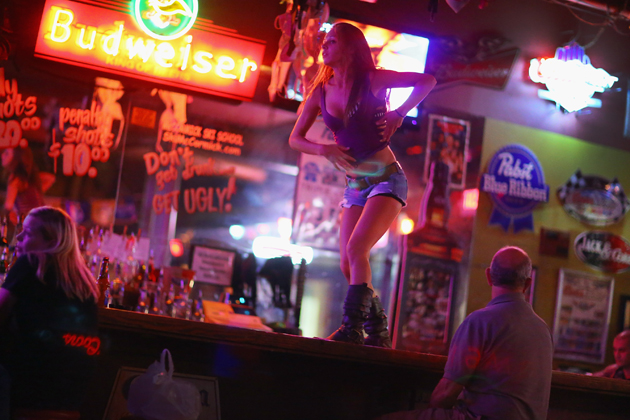 A bartender dances on the bar at a Coyote Ugly in Tampa, Fla. (Joe Raedle/Getty Images)