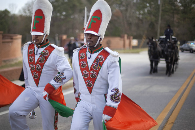Members of the Florida A&M band lead a horse-drawn carriage carrying the casket of fellow band member Robert Champion, Nov. 30, 2011. (David Goldman/AP)