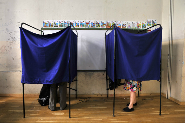 People vote inside booths during the elections in Thessaloniki, June 17, 2012. (Nikolas Giakoumidis/AP)