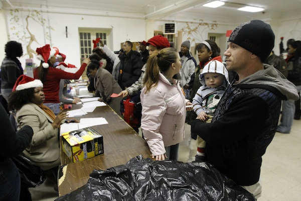 Ken Clark waits for a gift for his son at the Philadelphia Unemployment Project. AP Photo/Matt Rourke