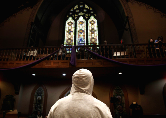 A man wears a hoodie before the start of a church service in New York, March 25, 2012. (Seth Wenig/AP)