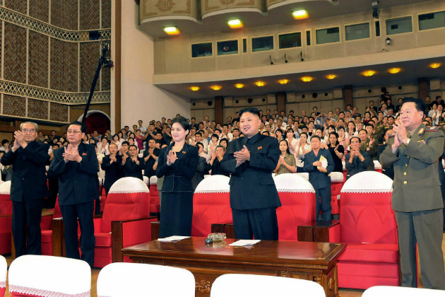 Kim Jong Un and a mystery woman clap at a performance in Pyongyang, July 6, 2012. (Korean Central News Agency)