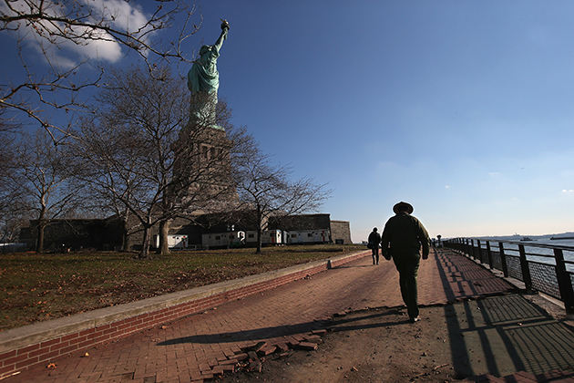 A park ranger patrols Liberty Island, which was damaged in Superstorm Sandy. (John Moore/Getty Images)