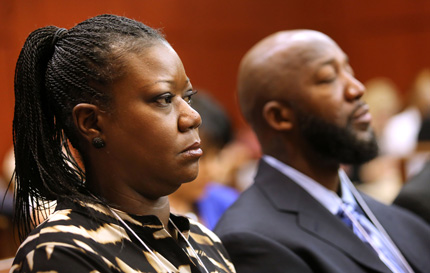 Sybrina Fulton and Tracy Martin, the parents of Trayvon Martin, listen as the charges against George Zimmerman are read in court. (Joe Burbank/AP)