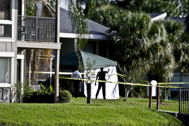 Investigators stand outside Ibragim Todashev's apartment complex in Orlando, May 22, 2013. (John Raoux/AP)