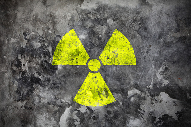 Radiation sign on grey wall. (photo: Thinkstock)