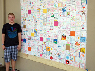 Ryan Andresen stands in front of his service project to promote anti-bullying awareness. (Andresen family)
