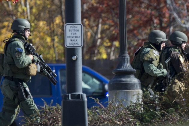 A tactical unit responds to the shooting in Brookfield, Wis. (AP)