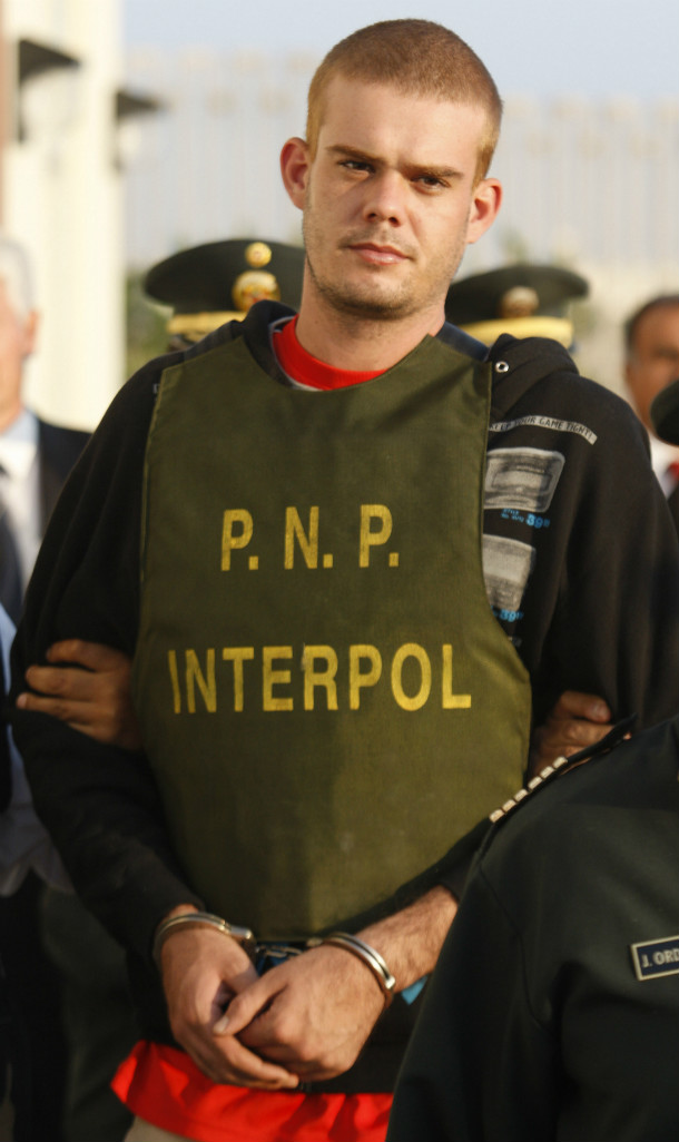 Joran van der Sloot is escorted by police officers outside a Peruvian police station, June 4, 2010. (AP/File)