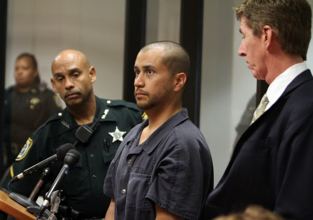 George Zimmerman, center, stands with a Seminole County deputy and his attorney Mark O'Mara during a court hearing April 12, 2012. (Pool/AP)