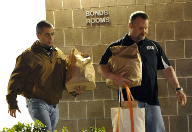 George Zimmerman, left, walks out of jail after posting a $150,000 bond on April 22, 2012. (Brian Blanco/AP)