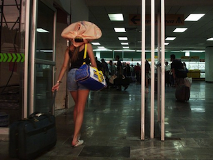 An unidentified passenger walks through the Cancun airport terminal. (AAP)
