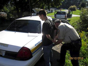 Dyllan Naecher being taken into custody (Tazewell County)