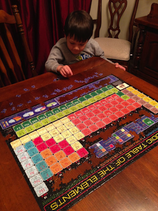 Gus Dorman puts together a puzzle picture of the Periodic Table of Elements (Rob Dorman/ABC News)