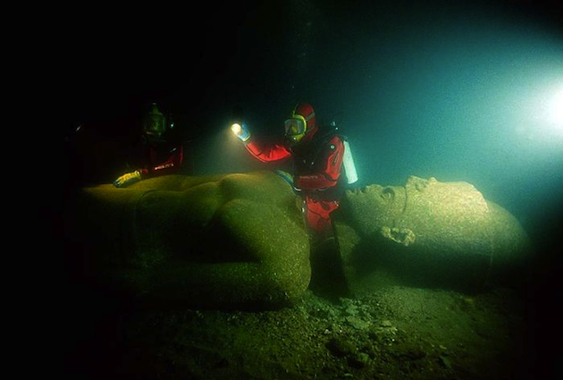 A researcher looks over a sunken statue from Heracleion (Christoph Gerigk/Franck Goddio/Hilti Foundation)
