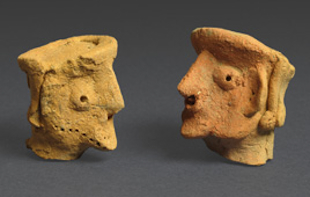 Two head figurines discovered at the 2,750-year-old site (Clara Amit, courtesy Israel Antiquities Authority)