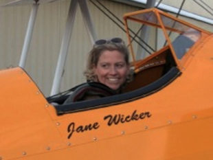 Jane Wicker aboard her personalized plane (wingwalk.org)
