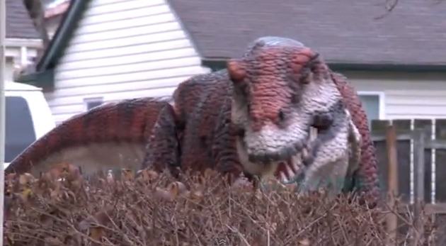 An animatronic T. rex emerges to prank innocent bystanders in Ohio. (YouTube)