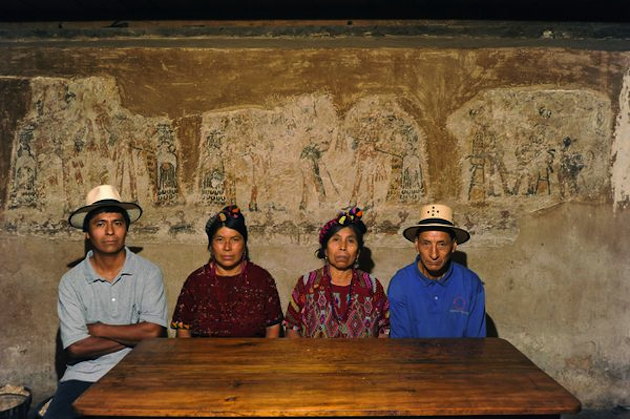 The Ramírez family sits in front of the Mayan mural discovered inside its home. (Photo by Robert Slabonski)