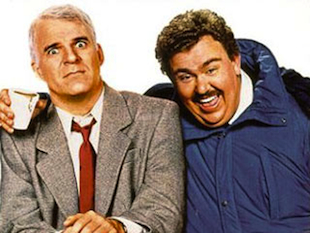 "Steve Martin and John Candy in ""Planes, Trains and Automobiles"""
