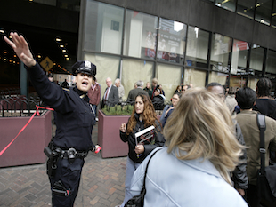 A police officer directs traffic outside New York's PortAuthority bus terminal (Seth Wenig/AP)