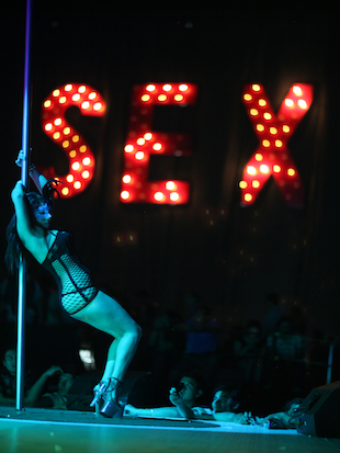 An exotic dancer performs during the 2012 Sex and Entertainment Expo in Mexico City (Alexandre Meneghini/AP)