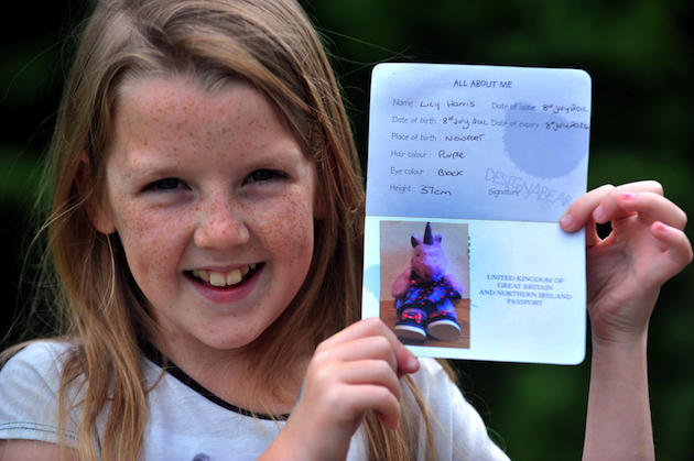 Emily Harris, 9, and unicorn passport (Caters)