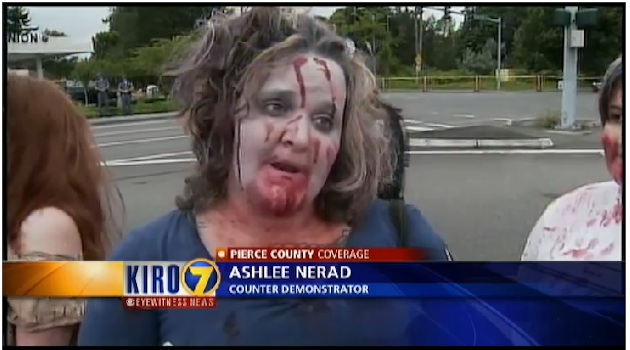 Using zombie makeup to protest anti-military demonstrators (KIRO-TV.com)