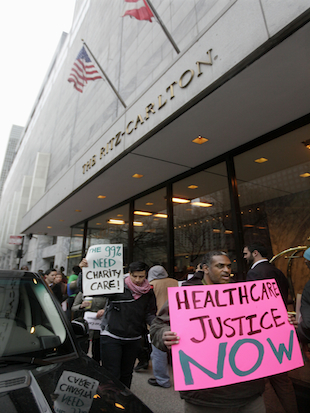 Protestors from the Fair Care Coalition, outside the Ritz-Carlton Chicago Hotel; March 1, 2012. (AP/M. Spencer Green)