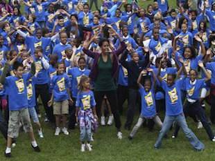 Michelle Obama sets the world record for jumping jacks (AP)